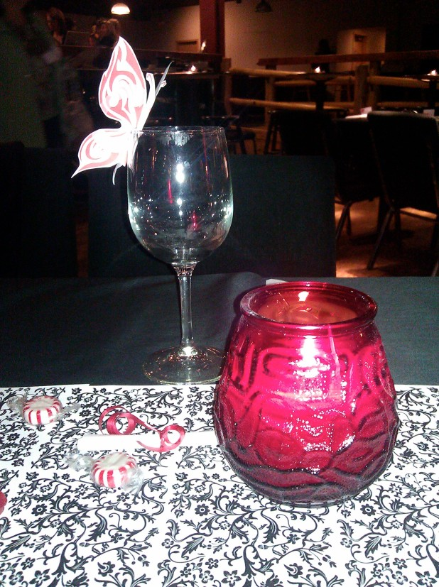 a glass and candle on the table