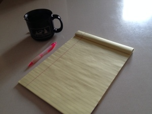 the supplies are ready: a notepad and some hot tea