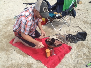 preparing lunch on the Biolite.  Love that little stove!